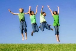 group of happy smiling summer children jumping